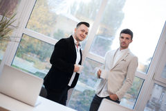 Two coworkers talking Stock Images