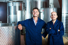 Two coworkers in wine factory Stock Images