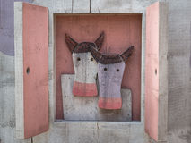 Two Cows Coming Out From Window Stock Photography