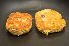Two Crab Cakes Frying Stock Images