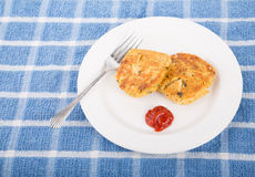 Two Crab Cakes on White Plate with Cocktail Sauce Stock Image
