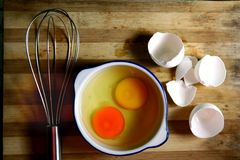 Free Two Cracked Eggs And A Whisk Royalty Free Stock Images - 40935029