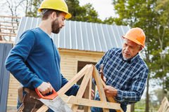 Two craftsmen working in team Royalty Free Stock Photo