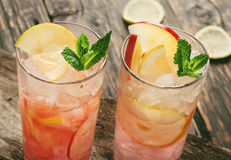 Two cranberry cocktail with ice, mint, lemon and apple Royalty Free Stock Photography