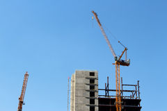 Two crane and a construction Royalty Free Stock Photography