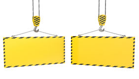 Two crane hooks with blank yellow plates Royalty Free Stock Photo