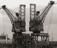 Two Cranes. Two riverside cranes used for unloading and loading barges, boats etc Stock Images
