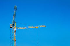 Two cranes against the blue sky. Stock Images