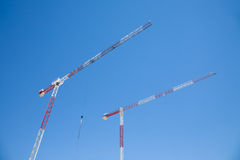 Two cranes in blue sky Stock Photography