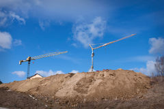 Two cranes on the construction site Stock Photo