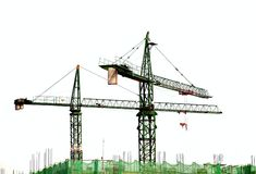 Two Cranes on a Construction Site Royalty Free Stock Photos