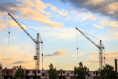 Two cranes. On the construction site, landscape photography Stock Photos