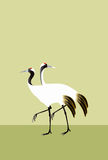 Two cranes on green background Royalty Free Stock Image