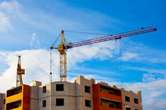 Two cranes and house construction Royalty Free Stock Photo