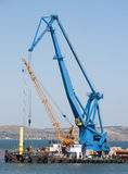 Two cranes for maritime cargo port in the Crimea Stock Images