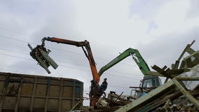 Two Cranes with Mechanical Claw Moves Metal Scrap. Two Crane with Mechanical Claw Moves Metal Scrap. Peel Grab stock footage