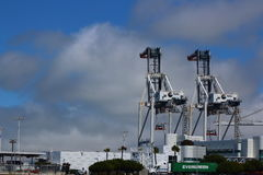 Two cranes for ship loading. These are two cranes in a shipping yard, Alameda, California Royalty Free Stock Images