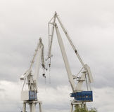 Two cranes in a shipyard Royalty Free Stock Photos