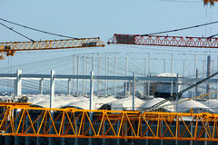 Two cranes on a site Stock Images