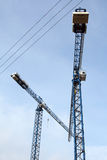 Two cranes in the sky Royalty Free Stock Photos