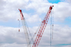 Two cranes and the sky Royalty Free Stock Images