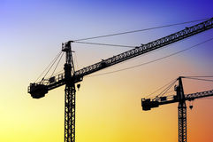 Two cranes at sunset Royalty Free Stock Images