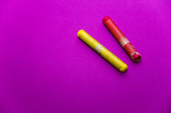 Two crayons on an empty paper Stock Images