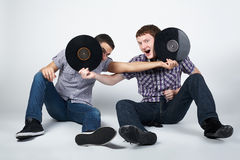Two crazy guys with plates Royalty Free Stock Images