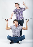 Two crazy guys with plates Stock Image