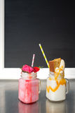 Two crazy milkshakes, with a blank blackboard Stock Image