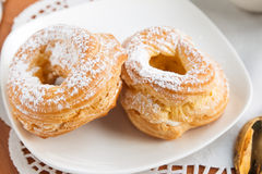 Two cream puffs Stock Image