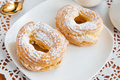 Two cream puffs Royalty Free Stock Image