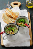 Two cream soup with broccoli and chick-pea Stock Photography