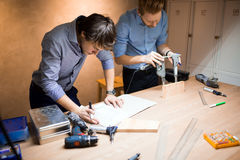 Two creative designers working in workshop Royalty Free Stock Photography