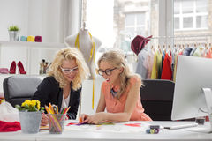 Two creative fashion designers looking at sketch Royalty Free Stock Photography