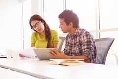 Two Creatives With Digital Tablet Working In Design Studio Stock Photos