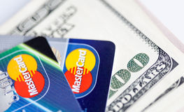 Two credit cards and dollar bills Stock Images