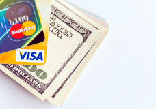 Two credit cards and dollar bills Stock Image