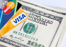 Two credit cards and dollar bills Royalty Free Stock Image