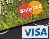 Two credit cards: Visa and Mastercard. RUSSIAN FEDERATION, OREL - 08 FEB 2016: Two credit cards: Visa and Mastercard Royalty Free Stock Photo