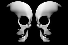 Two creepy skulls into darkness Royalty Free Stock Photography