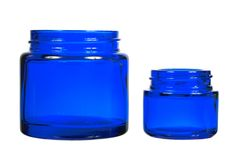 Two creme jars isolated on white background. Blue glass jars, front view isolated on white background Stock Images