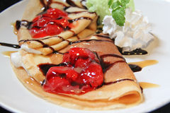 Two crepes with strawberries and Ice cream Royalty Free Stock Images