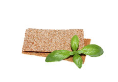 Two crispbread slices and basil Stock Photos