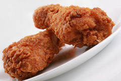 Two crispy fried chicken drumsticks Stock Image