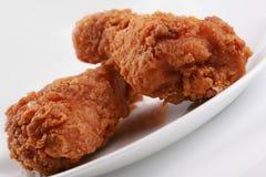 Two crispy fried chicken drumsticks stock image