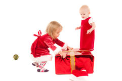 Two cristmas baby girls royalty free stock photography