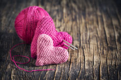 Two crochet pink hearts on wooden background. With copy space Royalty Free Stock Images