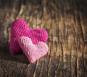 Two crochet pink hearts on wooden background Royalty Free Stock Photo