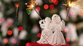 Two crocheted christmas angel decorations with sparklers stock footage